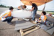 De VeloX2 wordt klaar gemaakt voor de testen. Het Human Power Team Delft en Amsterdam (HPT) traint op de RDW baan in Lelystad met de VeloX2 voor de recordpoging in september. Het HPT hoopt dan in Amerika meer dan 133 km/h te rijden over 200 meter.<br /> <br /> The VeloX2 is being prepared for the test run. Human Powered Team Delft and Amsterdam (HPT) is training at the RDW test track in Lelystad with the VeloX2 for the record attempt in september.