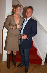 SOREN JESSEN and NATASHA ILLUM BERG at a private view of artist Adam Bricusse's paintings entitles 'The Mysteries Within' held at the Charing X Gallery, 121-125 Charing Cross Road, London WC2 on 12th September 2006.<br /><br />NON EXCLUSIVE - WORLD RIGHTS