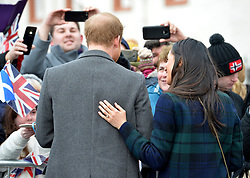 Prince Harry and Meghan Markle during a walkabout on the esplanade at Edinburgh Castle, during their visit to Scotland.