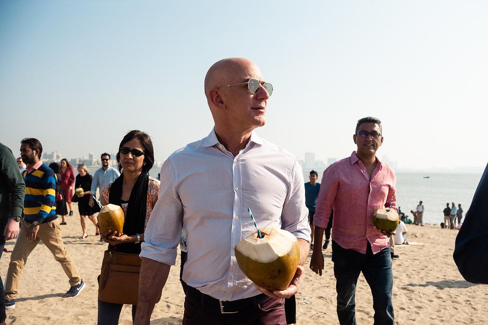 MUMBAI, INDIA – JANUARY 17, 2020: Amazon president Jeff Bezos visits Chowpatty Beach on the Mumbai coast with friends and colleagues.