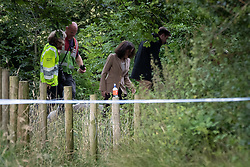© Licensed to London News Pictures. 03/08/2019. Whaley Bridge, UK. THERESA VILLIERS , Secretary of State for Environment, Food and Rural Affairs , is seen treading through undergrowth , close to the reservoir . The town of Whaley Bridge in Derbyshire remains evacuated after heavy rain caused damage to a slipway on the Toddbrook Reservoir , threatening homes and businesses with flooding. Photo credit: Joel Goodman/LNP