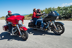 Fabrizio Panzarino (of Italy) out riding with Danilo Dibierro (also of Italy) and Melissa Shoemaker on their rented Harley-Davidson dressers during Daytona Bike Week. FL, USA. March 14, 2014.  Photography ©2014 Michael Lichter.
