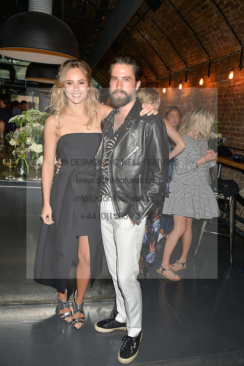 SUKI WATERHOUSE and JACK GUINNESS at a party to launch the Amazon Fashion Photography Studio at 383 Geffrye Street, London E2 on 23rd July 2015.