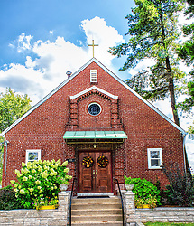 This is the smaller chapel building next door to the Immaculate Heart of Mary church