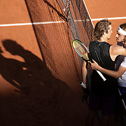 PARIS, FRANCE June 11.  Winner Stefanos Tsitsipas of Greece and Alexander Zverev of Germany embrace at the net after their five set match on Court Philippe-Chatrier during the semi finals of the singles competition at the 2021 French Open Tennis Tournament at Roland Garros on June 11th 2021 in Paris, France. (Photo by Tim Clayton/Corbis via Getty Images)