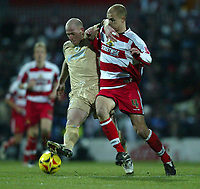 Photo: Aidan Ellis.<br /> Doncaster Rovers v Bristol City. Coca Cola League 1.<br /> 26/11/2005.<br /> Bristol's Steve Brooker battles With Doncaster's Stephen Roberts
