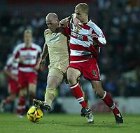 Photo: Aidan Ellis.<br /> Doncaster Rovers v Bristol City. Coca Cola League 1.<br /> 26/11/2005.<br /> Bristol's Steve Brooker battles With Doncaster's Stephen Roberts