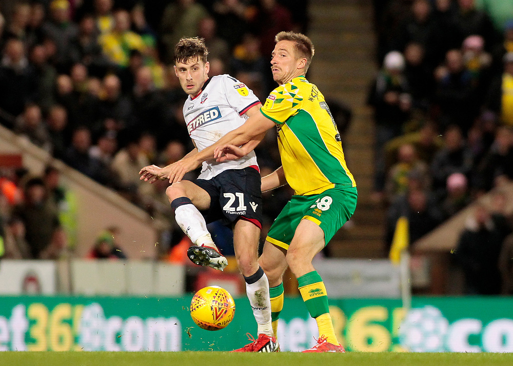 Bolton Wanderers' Joe Williams gets away from Norwich City's Marco Stiepermann<br /> <br /> Photographer David Shipman/CameraSport<br /> <br /> The EFL Sky Bet Championship - Norwich City v Bolton Wanderers - Saturday 8th December 2018 - Carrow Road - Norwich<br /> <br /> World Copyright © 2018 CameraSport. All rights reserved. 43 Linden Ave. Countesthorpe. Leicester. England. LE8 5PG - Tel: +44 (0) 116 277 4147 - admin@camerasport.com - www.camerasport.com