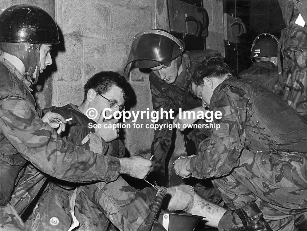 Corporal Peter Booth, Royal Green Jackets, gets immediate medical attention after being shot in the knee in the Bogside, Londonderry, N Ireland. The incident was one of three shooting incidents when a total of 15 shots were fired at British soldiers following an earlier civil rights meeting. 197107270777a.<br /> <br /> Copyright Image from Victor Patterson, Belfast, UK<br /> <br /> t: +44 28 9066 1296 (from Rep of Ireland 048 9066 1296)<br /> m: +44 7802 353836<br /> e: victorpattersonbelfast@gmail.com<br /> <br /> www.images4media.com<br /> <br /> Please see my full Terms and Conditions of Use at https://www.images4media.com/p/terms-conditions - it is IMPORTANT that you familiarise yourself with them.<br /> <br /> Images used online incur an additional cost. This cost should be agreed in writing in advance. Online images must be visibly watermarked i.e. © Victor Patterson or that of the named photographer within the body of the image. The original metadata must not be deleted from images used online.<br /> <br /> This image is only available for the use of the download recipient i.e. television station, newspaper, magazine, book publisher, etc, and must not be passed on to a third party. It is also downloaded on condition that each and every usage is notified within 7 days to victorpattersonbelfast@gmail.com.<br /> <br /> The right of Victor Patterson (or the named photographer) to be identified as the author is asserted in accordance with The Copyright Designs And Patents Act (1988). All moral rights are asserted.
