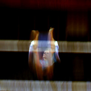 A blur of motion as a Canadian gymnast performs on the uneven bars during the Women's Artistic Gymnastics podium training at North Greenwich Arena during the London 2012 Olympic games preparation at the London Olympics. London, UK. 26th July 2012. Photo Tim Clayton