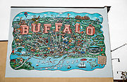 SHOT 10/23/17 11:24:56 AM - A mural of iconic Buffalo locations on the side of a building on Hertel Avenue in Buffalo, N.Y. The mural features the artwork of illustrator Mario Zucca that was printed in panels and applied directly to the wall. Councilman Joel Feroleto is loving the idea of having murals populate North Buffalo. He feels that the murals bring more visitors into the neighborhood. Buffalo, N.Y. is the second most populous city in the state of New York and is located in Western New York on the eastern shores of Lake Erie and at the head of the Niagara River. By 1900, Buffalo was the 8th largest city in the country, and went on to become a major railroad hub, the largest grain-milling center in the country and the home of the largest steel-making operation in the world. The latter part of the 20th Century saw a reversal of fortunes: by the year 1990 the city had fallen back below its 1900 population levels. (Photo by Marc Piscotty / © 2017)