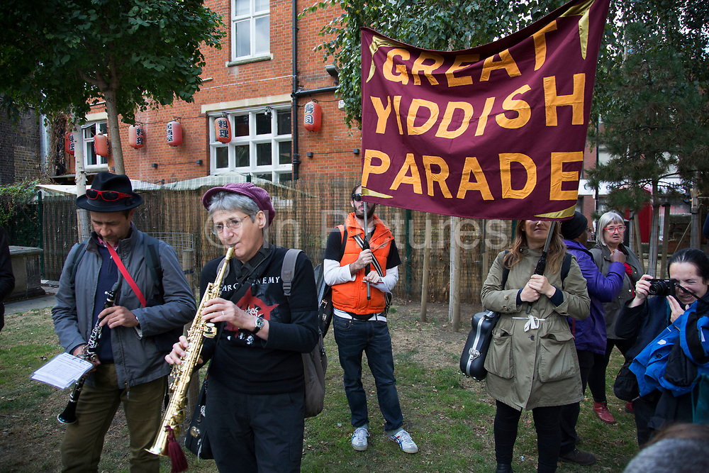Great Yiddish Parade band playing in Altab Ali Park during the Cable Street 80 march and rally through Whitechapel to mark the 80th anniversary of the Battle of Cable Street on 9th October 2016 in London, United Kingdom. The demonstration marks the day when tens of thousands of people across the East End, joined by others who came to support them, prevented Oswald Mosley's British Union of Fascists invading the Jewish areas of the East End. The day, which is recognised as a major turning point in the struggle against fascism in Britain in the 1930s, became known as the Battle of Cable Street.
