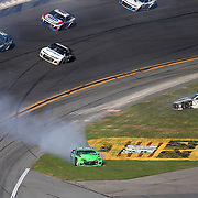 Danica Patrick, driver of the #7 GoDaddy Chevrolet is seen after crashing with Chase Elliott, driver of the (9) NAPA Autoparts Chevrolet, and Kasey Kahne, driver of the (95)Procore Chevrolet during the 60th Annual NASCAR Daytona 500 auto race at Daytona International Speedway on Sunday, February 18, 2018 in Daytona Beach, Florida. This would be Patrick's final NASCAR race.  (Alex Menendez via AP)