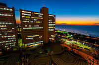 A building and the Mediterranean Sea during twilight, seen from the Dan Panorama Hotel along the beach front, Tel Aviv, Israel.