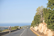 Israel, Carmel Mountain, Shekef Forest, Cyclist The Mediterranean sea in the background