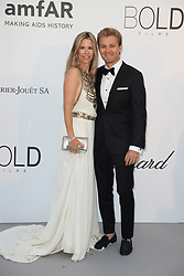 Nico Rosberg (R) and Vivian Sibold arrive at the amfAR Gala Cannes 2018 at Hotel du Cap-Eden-Roc on May 17, 2018 in Cap d'Antibes, France. Photo by Shootpix/ABACAPRESS.COM