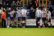 Fan celebrating with Millwall midfielder Shane Ferguson (18)scoring 3-0 with fan during the The FA Cup 3rd round match between Millwall and Bournemouth at The Den, London, England on 7 January 2017. Photo by Matthew Redman.