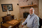 Richard S. Lowry, 61, a military historian and author, is portrayed in his living room in Orlando, FL, USA. Mr Lowry is the author of the book 'New Dawn, The Battles for Fallujah', published in May, 2010.