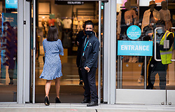 © Licensed to London News Pictures. 24/07/2020. London, UK. A shoppers wearing a mask entering Primark on Oxford Street in central London, on the day that the wearing of mask in shops becomes compulsory. The UK Government has published formal guidance on spaces where the wearing of masks will now be mandatory, including in shops, supermarkets and shopping centres. Photo credit: Ben Cawthra/LNP