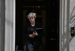 Prime Minister Theresa May prepares to make a statement in Downing Street after chairing a meeting of the Government's emergency Cobra committee following last night's terrorist incident in London.