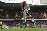 Angel Rangel of Swansea City and Son Heung-Min of Tottenham Hotspur both jump for the ball. Barclays Premier league match, Tottenham Hotspur v Swansea city at White Hart Lane in London on Sunday 28th February 2016.<br /> pic by John Patrick Fletcher, Andrew Orchard sports photography.