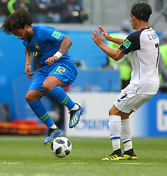 June 22, 2018 - Saint Petersburg, Russia - Marcelo (L) of the Brazil national football team and Christian Bolanos of the Costa Rica national football team vie for the ball during the 2018 FIFA World Cup match, first stage - Group E between Brazil and Costa Rica at Saint Petersburg Stadium on June 22, 2018 in St. Petersburg, Russia. (Credit Image: © Igor Russak/NurPhoto via ZUMA Press)