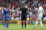 Referee Kevin Friend breaks up an argument between Yohan Cabaye of Crystal Palace (l) and Charlie Adam of Stoke City. Barclays Premier League match, Crystal Palace v Stoke City at Selhurst Park in London on Saturday 7th May 2016. pic by John Patrick Fletcher, Andrew Orchard sports photography.