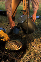 serving fresh hot food and drinks from the campfire