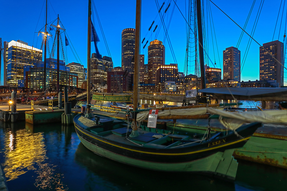 Sail Boston tall ship Essex moored at Fan Pier in the Boston Harbor with waterfront skyline photography from New England photographer Juergen Roth. The image shows the historic sailboat in front of the Boston Financial Waterfront District landmarks such as the Custom House of Boston, One International Place, Boston Harbor Hotel photographed on a beautiful summer sunset evening. <br /> <br /> Sail Boston photos are available as museum quality photo prints, canvas prints, wood prints, acrylic prints or metal prints. Fine art prints may be framed and matted to the individual liking and decorating needs:<br /> <br /> https://juergen-roth.pixels.com/featured/sail-boston-tall-ship-essex-juergen-roth.html<br /> <br /> All digital Boston tall ships photography images are available for photo image licensing at www.RothGalleries.com. Please contact me direct with any questions or request.<br /> <br /> Good light and happy photo making!<br /> <br /> My best,<br /> <br /> Juergen<br /> Prints: http://www.rothgalleries.com<br /> Photo Blog: http://whereintheworldisjuergen.blogspot.com<br /> Instagram: https://www.instagram.com/rothgalleries<br /> Twitter: https://twitter.com/naturefineart<br /> Facebook: https://www.facebook.com/naturefineart