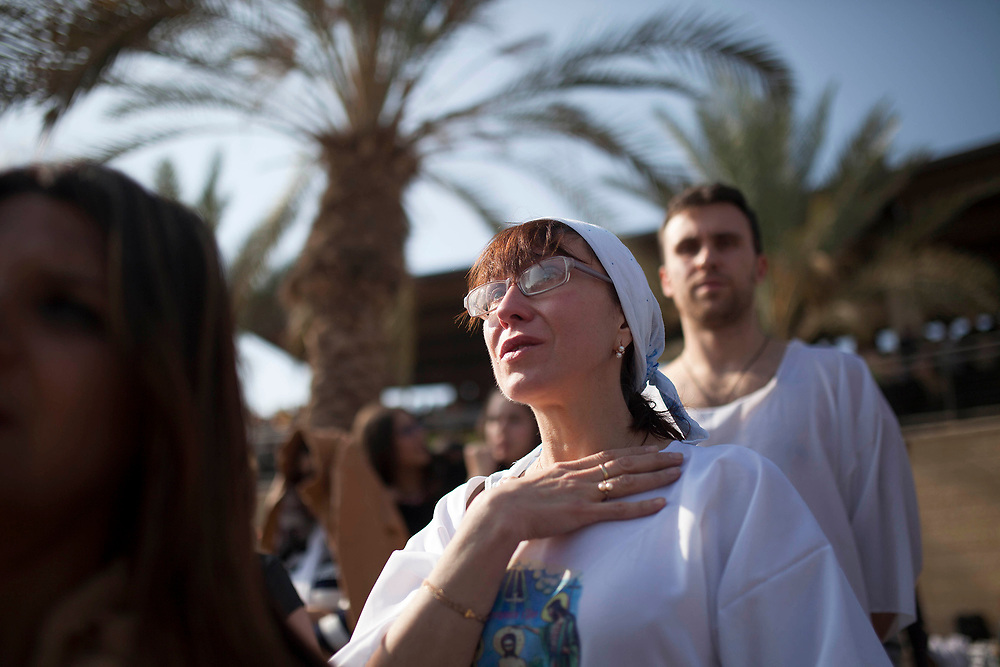 """Jan 18, 2014 - Jerico, West Bank - Christian Orthodox pilgrims perform a baptism ceremony during the day of the Epiphany at the """"Qasr el Yahud"""" baptism site in the Jordan River Valley, near the West Bank city of Jerico.The Epiphany celebrates the baptism of Jesus, which belived to be in this same location."""