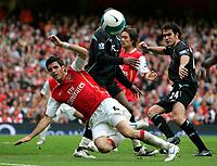Photo: Tom Dulat.<br /> Arsenal v Bolton Wanderers. The FA Barclays Premiership. 20/10/2007.<br /> Joey O'brien of Bolton Wanderers and Cesc Fabregas of Arsenal watching the ball.