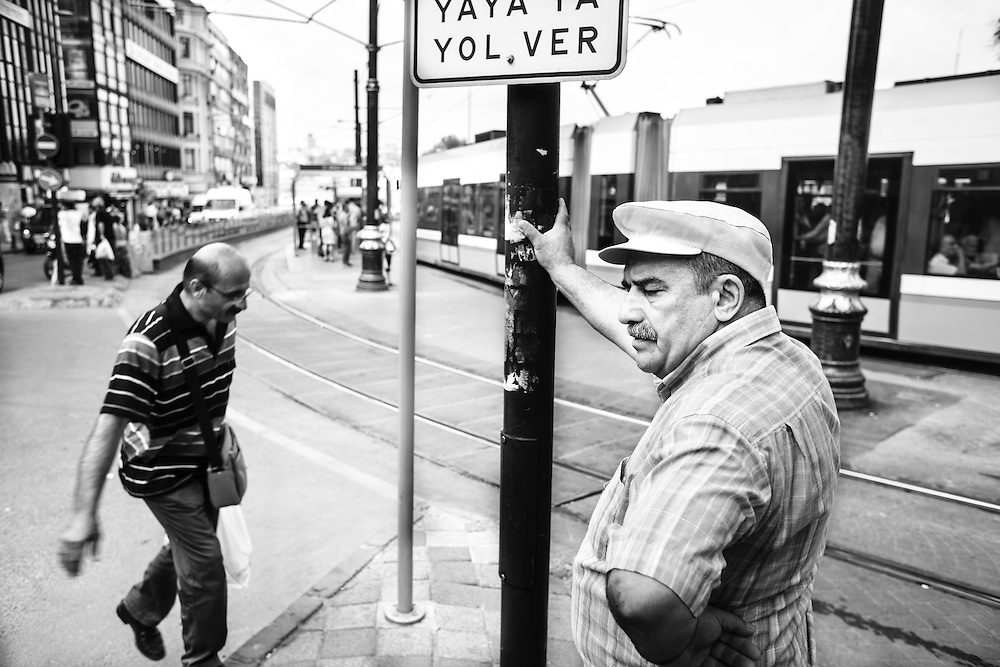 A man waits for the tram in front of Sırkesı Train Station in Istanbul