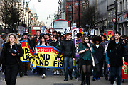 Student Demonstration closes Oxford Street in London. Young people protest against many different government policies at this demonstration which included a sit down protest blocking Oxford Circus.