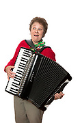 Mature women playing accordion