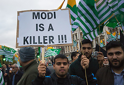 Parliament Square, London, November 12th 2015. As India's Nahendra Modi visits Gandhi's statue in Parliament Square, hundreds of Indians opposed to his rule, including Sikhs and Kashmiris, demonstrate against him as he visits Britain. The accuse the Indian Prime Minister of religious discrimination and human rights abuses.