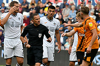 Football - 2021 / 2022 EFL Sky Bet Championship - Swansea City vs Hull City - Liberty Stadium - <br /> <br /> shows the red card to is surrounded after Ethan Laird Swansea City is brought down in the penalty area<br /> <br /> COLORSPORT/WINSTON BYNORTH