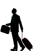 one caucasian business traveler man walking with suitcase lost looking up  full length silhouette in studio isolated white background