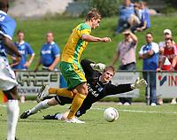 Photo: Maarten Straetemans.<br /> AGOVV Apeldoorn v Norwich City. Pre Season Friendly. 21/07/2007.<br /> David Strihavka is trying to pass goalkeeper Daan Huiskamp from Apeldoorn.