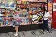 Wonka bar in a sweet shop window as two women check their smartphones on 2nd July 2021 in London, United Kingdom. Willy Wonka & the Chocolate Factory is a 1971 American musical fantasy film directed by Mel Stuart and starring Gene Wilder as Willy Wonka. It is an adaptation of the 1964 novel Charlie and the Chocolate Factory by Roald Dahl.