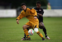 Photo: Rich Eaton.<br /> <br /> Carmarthen Town v SK Brann. UEFA Cup Qualifying. 19/07/2007. SK Brann's Tijan Jaiteh (r) tries to steal the ball from Camarthen's Tom Ramasut.