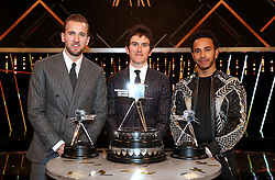 Geraint Thomas (centre) poses after winning the BBC Sports Personality of the Year award alongside third placed Harry Kane (left) and second placed Lewis Hamilton during the BBC Sports Personality of the Year 2018 at Birmingham Genting Arena.