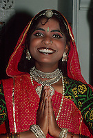 Rajasthani woman making namaste (welcome) gesture, Lake Palace Hotel, Udaipur, Rajasthan, India