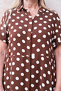 extreme close up of woman waring a dotted fabric design clothing
