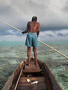 Old man named Sahad fishing off Bodgaya island.