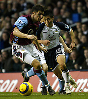 Photo: Chris Ratcliffe.<br />Tottenham Hotspur v Aston Villa. The Barclays Premiership. 21/01/2006.<br />Lee Young-Pyo (R) of Spurs takes on Aaron Hughes of Villa.