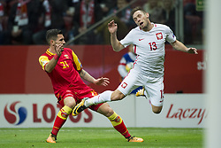 October 8, 2017 - Warsaw, Poland - Maciej Rybus of Poland and Emrah Klimenta of Montenegro during the FIFA World Cup 2018 Qualifying Round Group E match between Poland and Montenegro at National Stadium in Warsaw, Poland on October 8, 2017  (Credit Image: © Andrew Surma/NurPhoto via ZUMA Press)