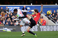 Daley Blind of Manchester United challenges Eduardo Vargas of QPR.  Barclays Premier league match, Queens Park Rangers v Manchester Utd at Loftus Road in London on Saturday 17th Jan 2015. pic by John Patrick Fletcher, Andrew Orchard sports photography.