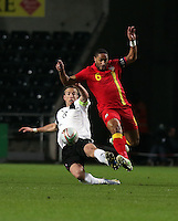 Pictured: Ashley Williams of Swansea (R) avoids a tackle by Marc Janko of Austria (L). Wednesday 06 February 2013..Re: Vauxhall International Friendly, Wales v Austria at the Liberty Stadium, Swansea, south Wales.