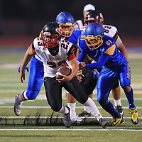 (Photograph by Bill Gerth/ for SVCN/9/1/17) Westmont #23 Stevie Lopez picks up some yardage vs Prospect in a preseason football game at Prospect High School, Saratoga CA on 9/1/17. (Westmont 20 Prospect 0)