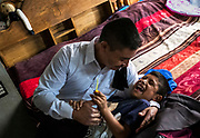 Rosalino tickles his son, Leandro, while getting dressed for his wedding. Nick Wagner / Alexia Foundation